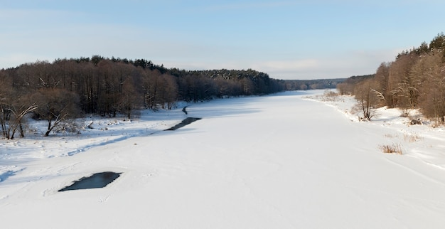 Frozen water in the river during frosts, winter season with frosts