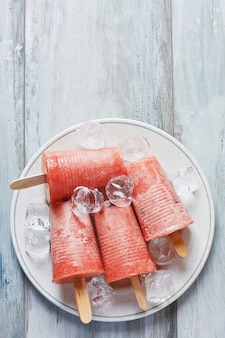 Frozen watermelon sorbet on plate. homemade ice cream.