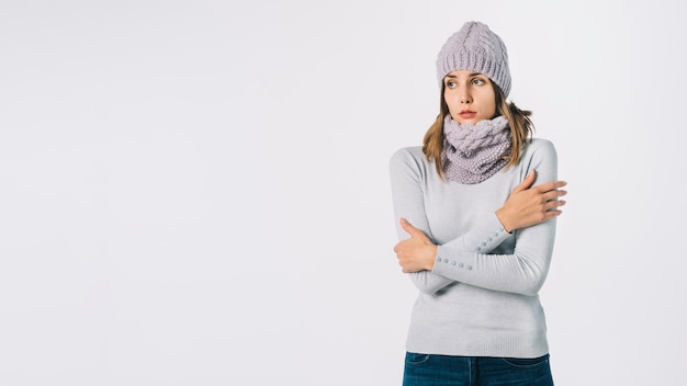 Frozen woman in grey clothes