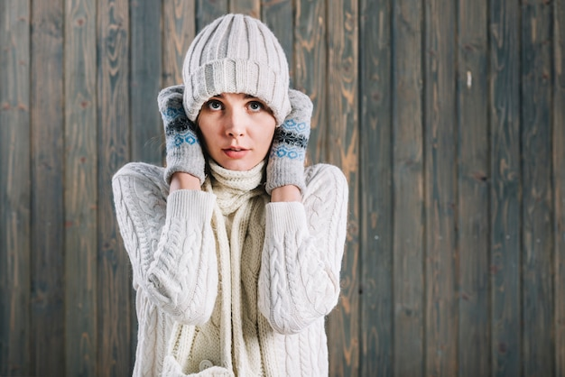Frozen woman in light sweater