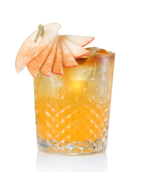 Fruit alcohol cocktail with apple and cinnamon stick isolated
