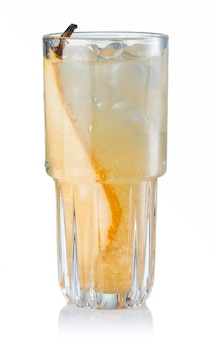 Fruit alcohol cocktail with pear slice isolated