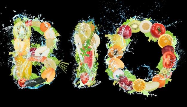 Фрукты и овощи, образующие слово «био». здоровая био-еда для оздоровительной концепции
