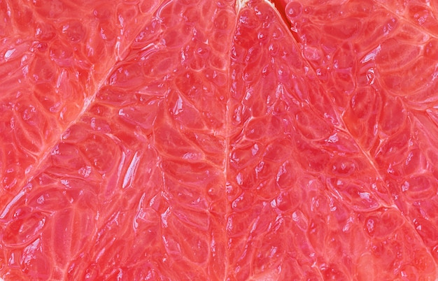 Fruit background of red grapefruit texture