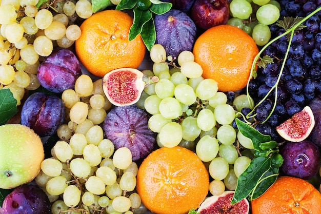 Fruit background with grape, orange, figs on blackboard background. healthy food