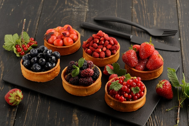 Fruit and berry tartlets dessert tray assorted.