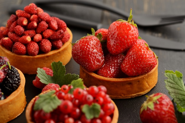 Fruit and berry tartlets dessert tray assorted