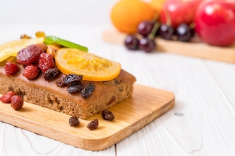 Fruit cake on wood