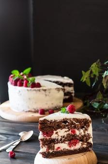 Fruit cake. raspberry cake with chocolate. chocolate cake. mint decor. cheesecake.