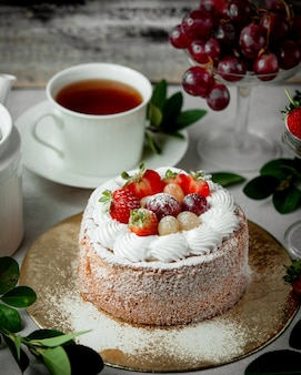 Fruit cake topped with strawberry white and red grape