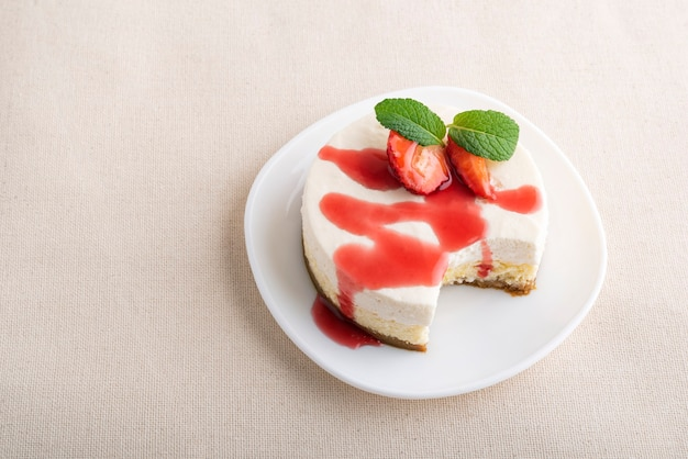 Fruit cheesecake, with fresh strawberries and berry juice.