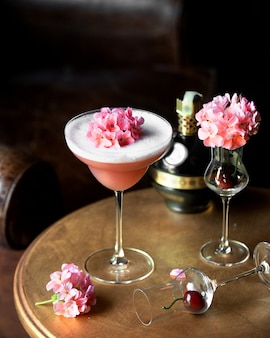 Fruit cocktail topped with flowers