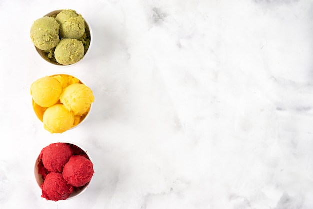 Fruit colorful sorbet on white background seeng from above