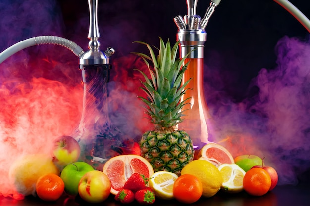 Fruit flavor hookah isolated on black close up