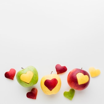 Fruit heart shapes and apples with copy space
