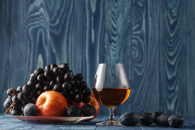 Fruit on her cover look interesting. cognac served with fruit.