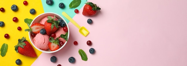 Fruit ice cream and ingredients on color