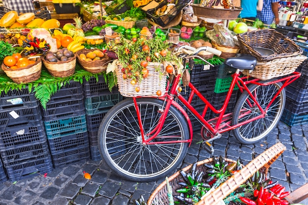Fruit market with old bike in campo di fiori, rome