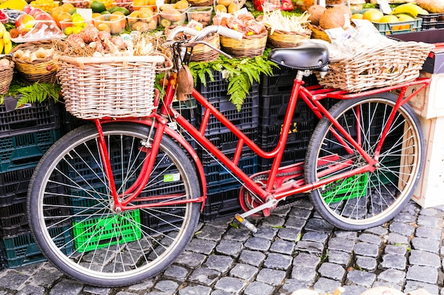 Fruit market with old reto bicycle in campo di fiori in rome