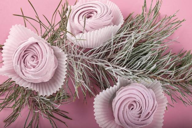 Fruit marshmallow handmade decorated christmas tree on pink background.