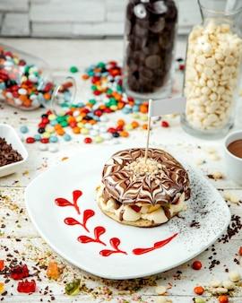 Fruit pancake coated with chocolate syrup