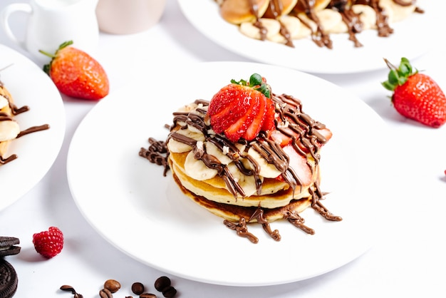 Fruit pancake topped with hot chocolate
