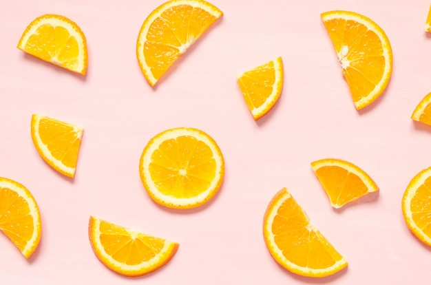 Fruit pattern of fresh orange slices on pastel background. top view.