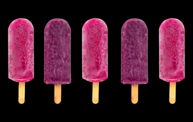Fruit popsicle  ice cream stick on purple and pink  strawberry popsicle
