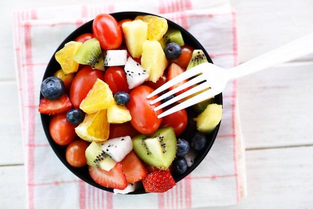 Fruit salad bowl fresh summer fruits and vegetable