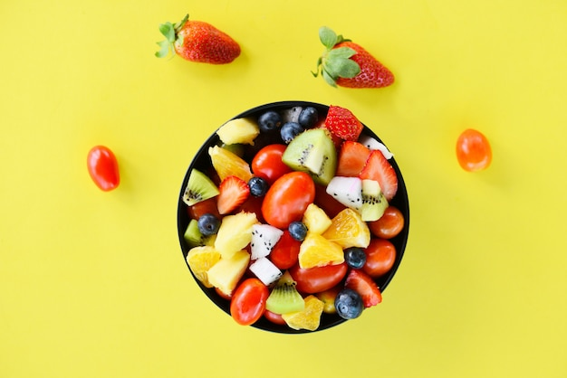 Fruit salad bowl fresh summer fruits and vegetables healthy organic food