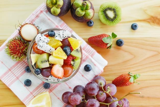 Fruit salad bowl fresh summer fruits and vegetables