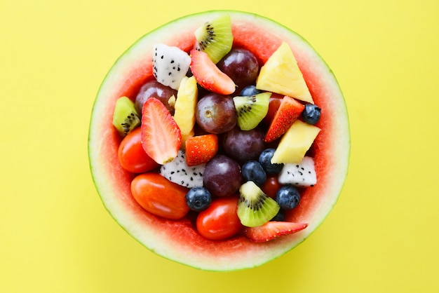 Fruit salad bowl served in a watermelon vegetables healthy food.