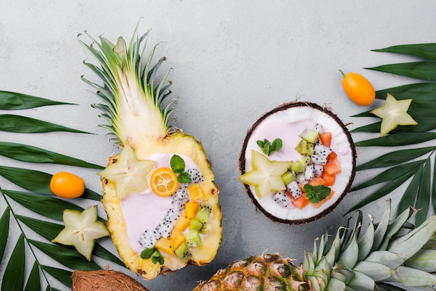 Fruit salad in coconut plate and pineapple