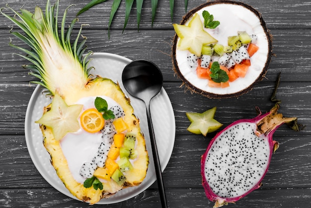 Fruit salad in coconut plate top view