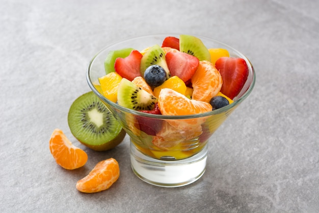Fruit salad in crystal bowl on gray