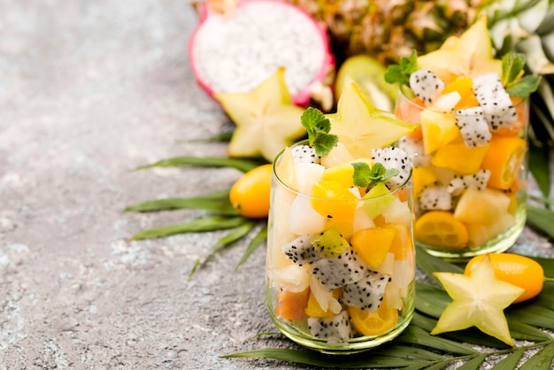 Fruit salad in glass copy space