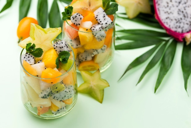 Fruit salad in glass and leaves