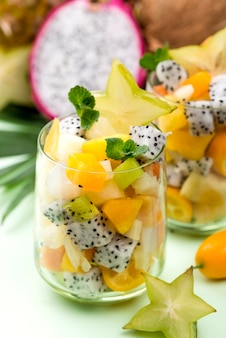 Fruit salad in glass and yogurt