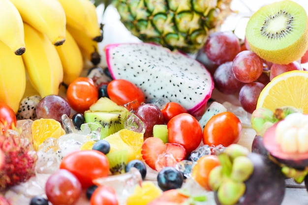 Fruit salad on ice fresh summer fruits healthy organic food.