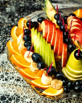 Fruit salad with apples, oranges, bananas, grapes and pears