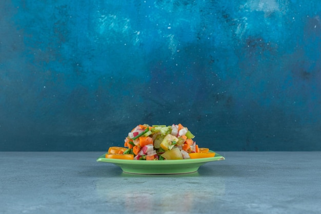 Fruit salad with chopped and sliced kiwies, mandarin and oranges.