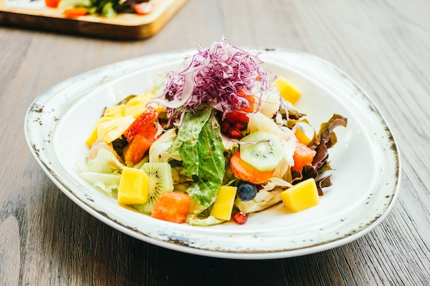 Fruit salad with vegetable in plate