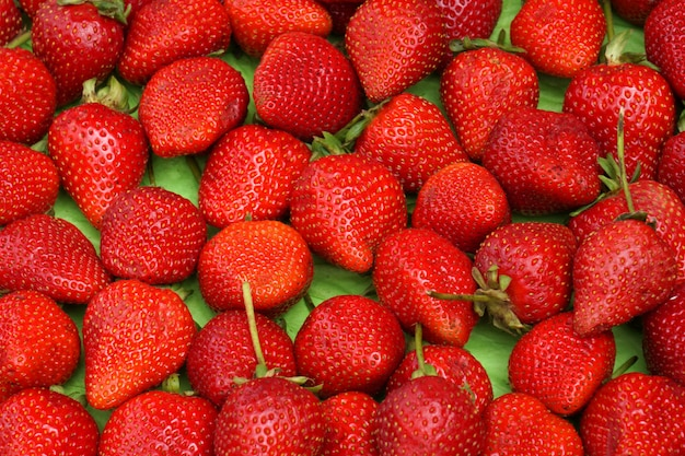 Fruit scene of fresh strawberry in the  fruit market - red patterns