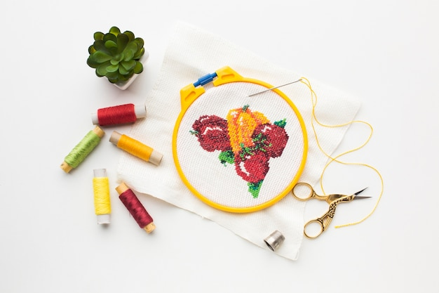 Fruit sewed design with sewing threads and plant