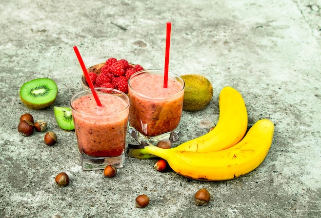 Fruit smoothie in glasses. on rustic background.