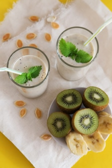 Fruit smoothie in glasses with milk