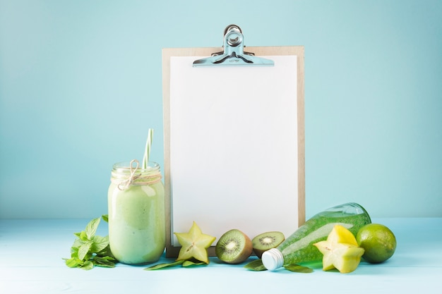 Fruit and smoothie with blank clipboard copyspace