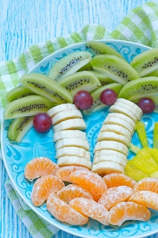 Fruit snack for kids with kiwi, banana and tangerine