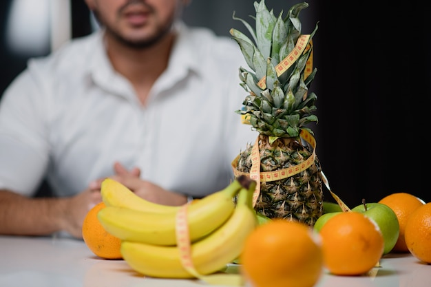 Fruit on the table closeup with a man