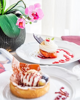 Fruit with cakes side view